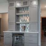 kitchen remodel with grey cabinetry and shleving with mosaic tile backsplash