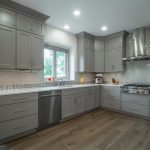 kitchen remodel with grey cabinetry and stainless steel appliances