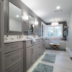 bathroom remodel with grey painted cabinetry and vinyl flooring