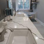 bathroom remodel with white veined granite vanity countertop