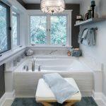 white whirlpool tub and crystal pendant lighting