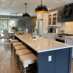black painted kitchen island with quartz countertop