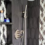 bathroom remodel with glass walk-in shower with tiled walls and stainless steel fixtures