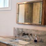 bathroom remodel with wooden vanity and granite vanity top