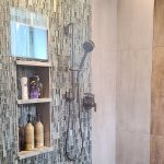 bathroom remodel with glass walk-in shower with mosaic tile on the walls and stainless steel brushed fixtures