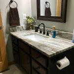 dark wood vanity and custom granite vanity top