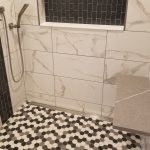 shower remodel with hexagon floor tile in the shower and marble wall tile